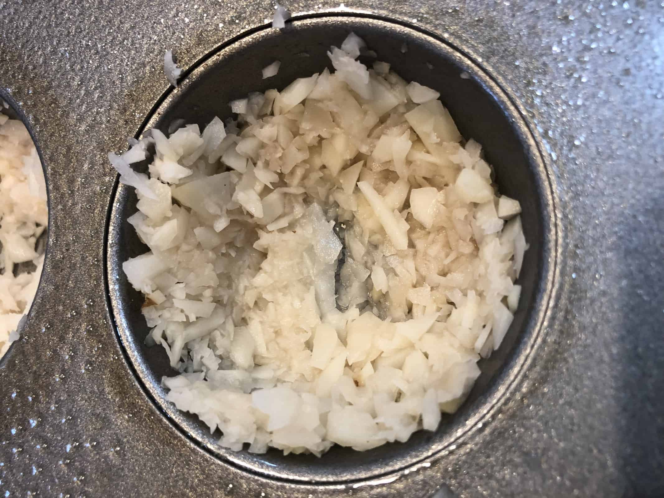 Shredded Potatoes pressed in muffin tin hole