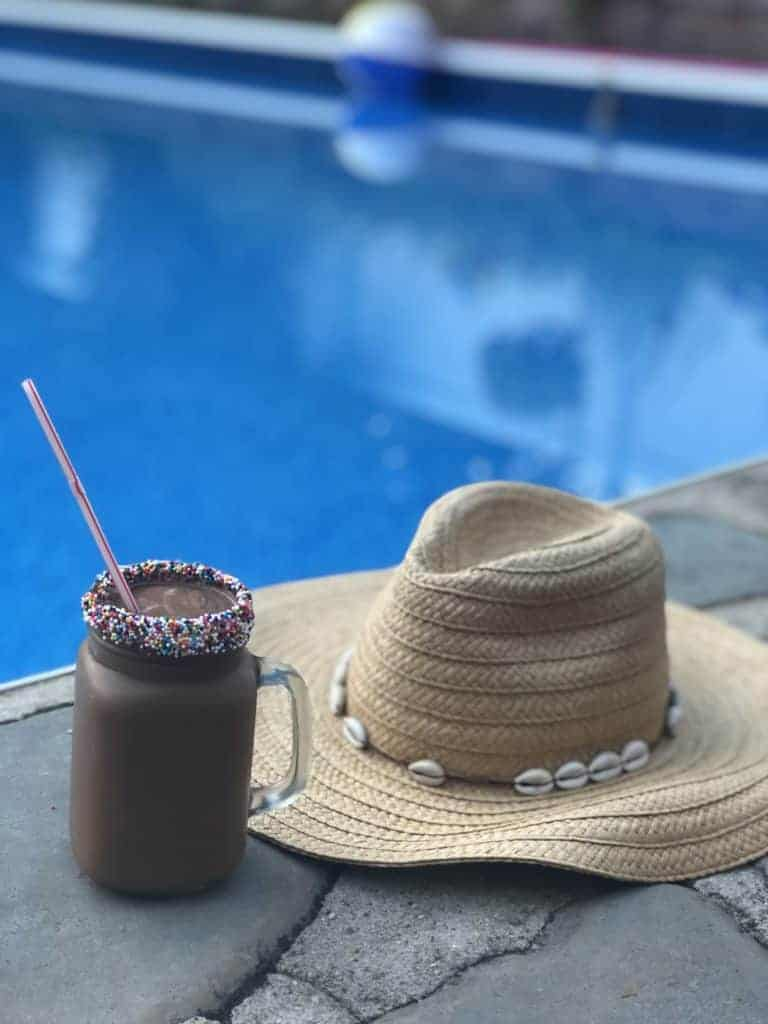 a hat and milkshake