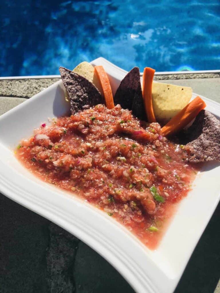 A bowl of Salsa by the pool