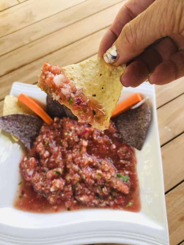 Dipping a chip in salsa