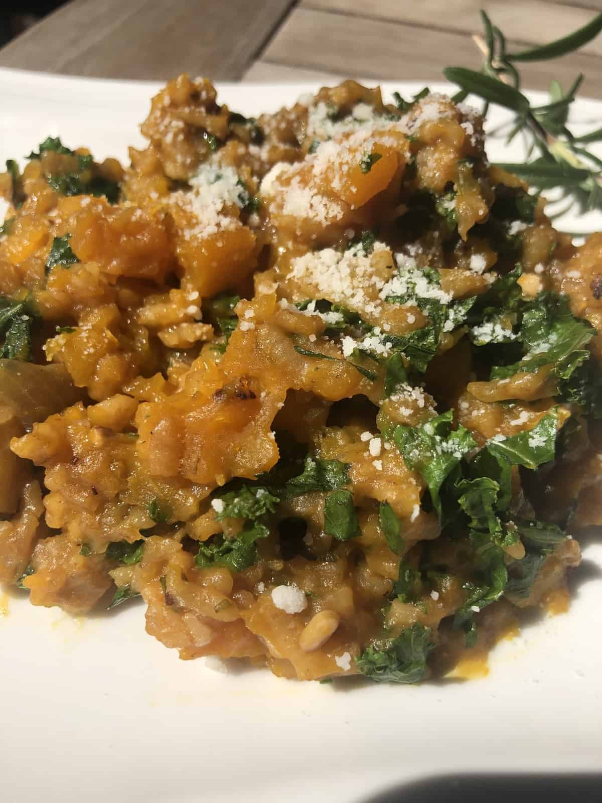 Butternut Squash Risotto with Kale on a white plate