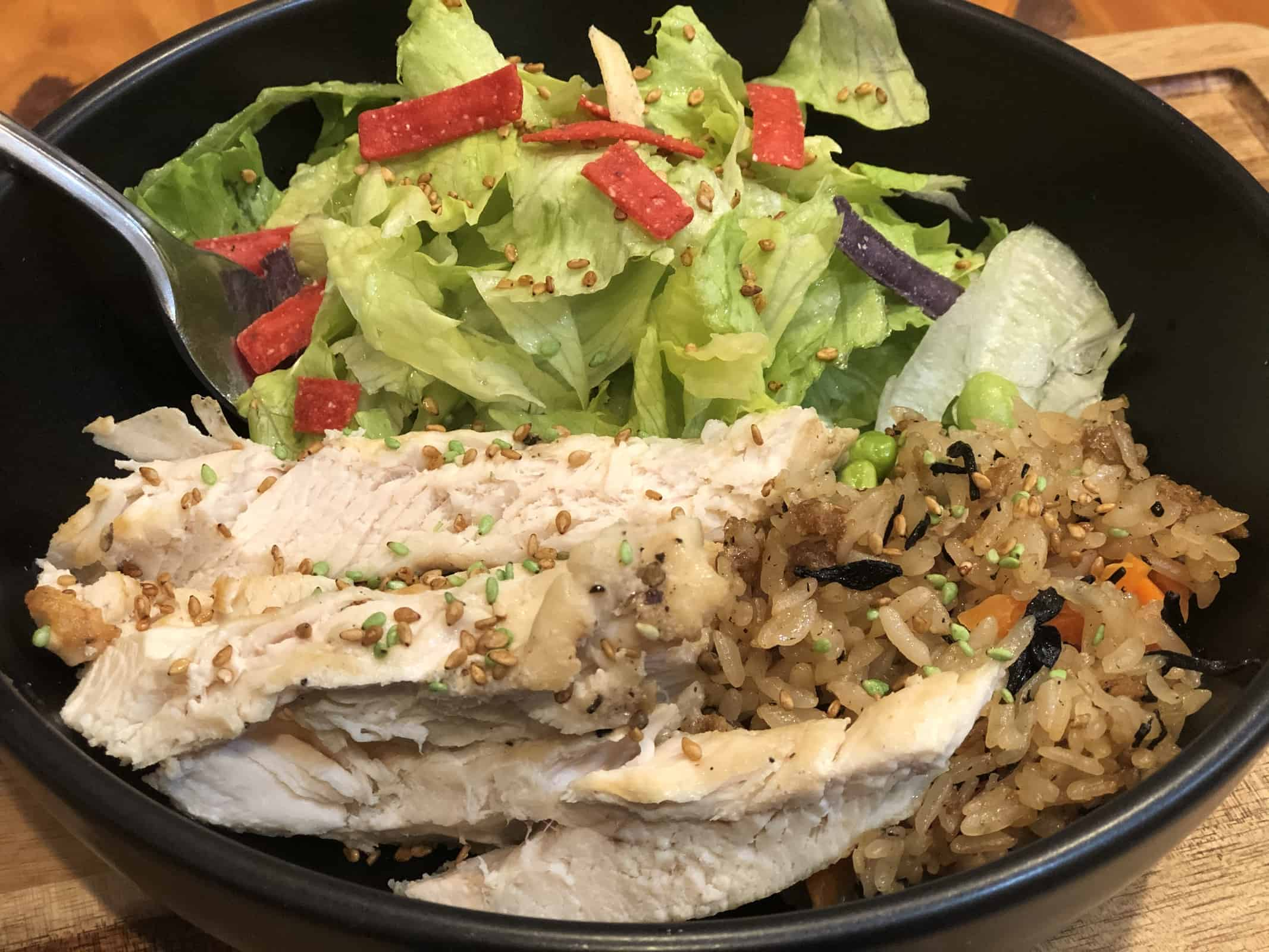 Instant Pot Chicken with Salad in a black bowl