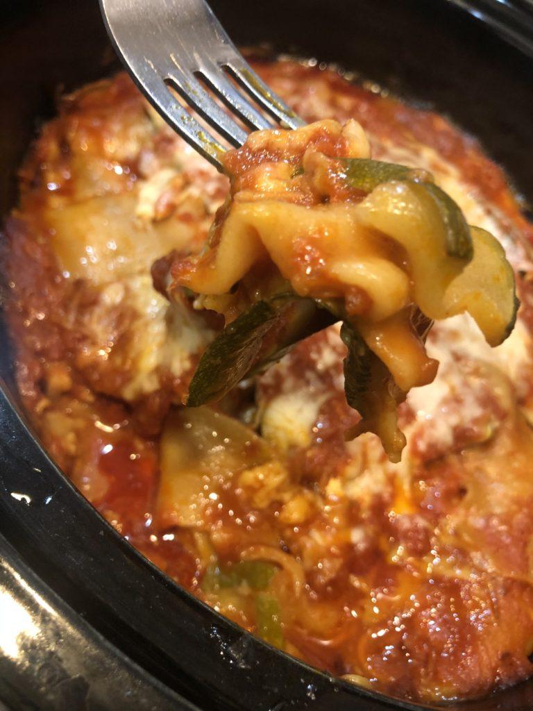 a forkful of crockpot lasagna