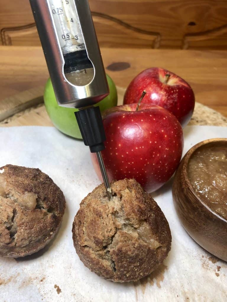 Injecting applesauce into a muffin