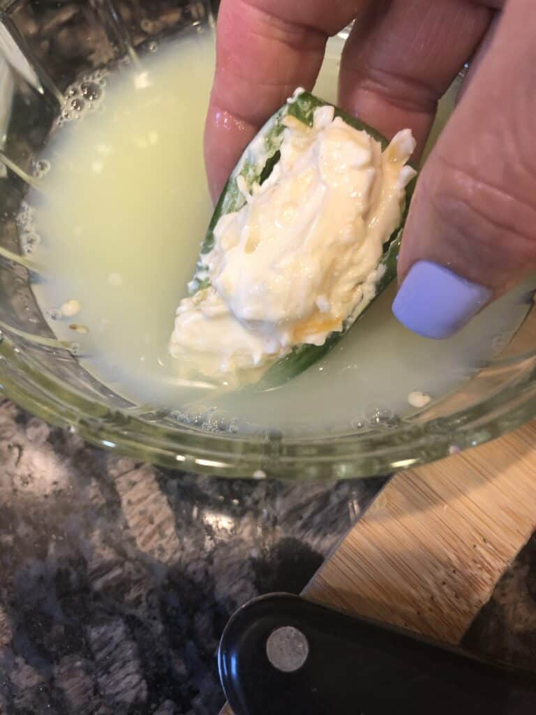 Dipping Stuffed Jalapeno in Egg Whites