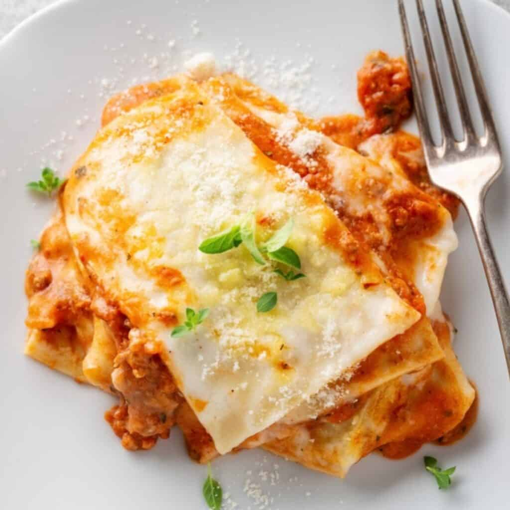 Lasagna on a plate with a fork