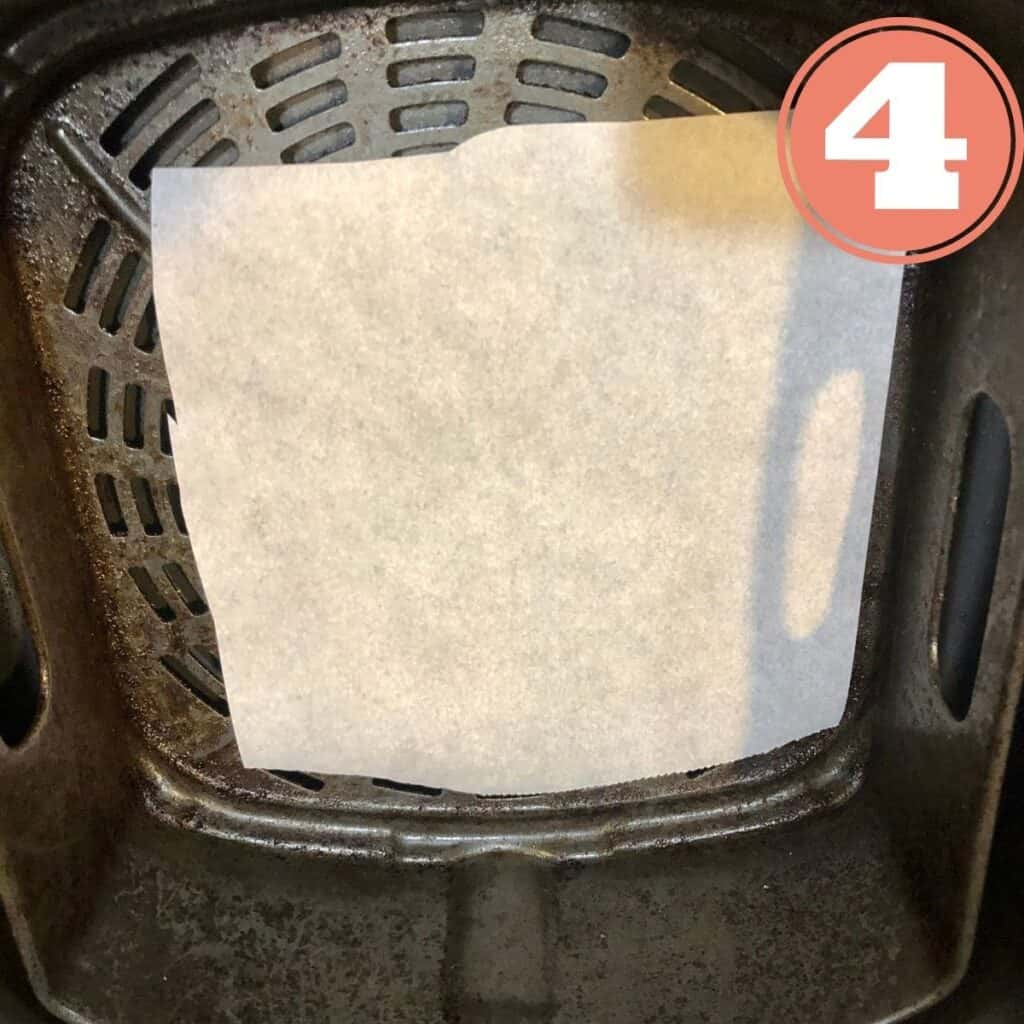 Parchment paper in the basket of a Ninja Foodie Air Fryer