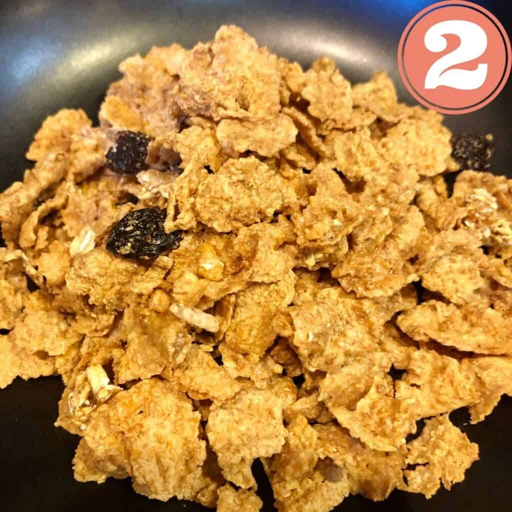 Corn Flakes in a black bowl